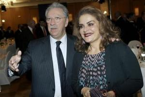 Chairman and chief executive officer of the Piraeus Bank, Michalis Sallas (L), escorts his wife Sophia Staikou during the first day of the American-Hellenic Chamber of Commerce conference in Athens, December 1, 2009. REUTERS/Icon/Elias Anagnostopoulos/Files